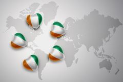 Five hearts with national flag of cote divoire on a world map background. Concept.3D illustration Royalty Free Stock Image