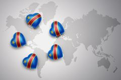 Five hearts with national flag of democratic republic of the congo on a world map background. Concept.3D illustration Royalty Free Stock Photography