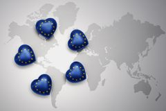 Five hearts with national flag of european union on a world map background. Concept.3D illustration Royalty Free Stock Photo