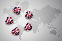 Five hearts with national flag of great britain on a world map background. Concept.3D illustration Stock Images