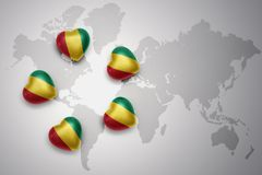 five hearts with national flag of guinea on a world map background Royalty Free Stock Image