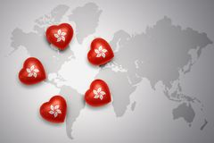 Five hearts with national flag of hong kong on a world map background. I love hong kong.concept Royalty Free Stock Photo