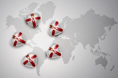 Five hearts with national flag of northern ireland on a world map background. Concept.3D illustration Royalty Free Stock Photography