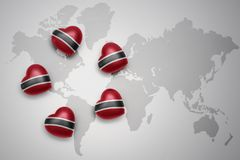 Five hearts with national flag of trinidad and tobago on a world map background. Concept.3D illustration Stock Photo
