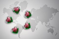Five hearts with national flag of wales on a world map background. Royalty Free Stock Image