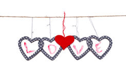 Five hearts with the word love hung up on the string. Isolated over white Royalty Free Stock Photos