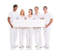 Five holding white board Royalty Free Stock Photo