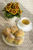 Homemade traditional Czech buns stuffed with plum jam, raisins and cottage cheese on white plate on the table with tea and flowe. Five homemade traditional Czech Stock Photo