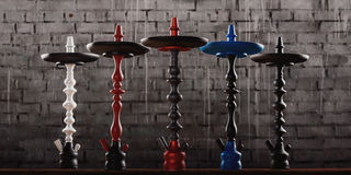 Five hookahs stand in a row against the wall Stock Images