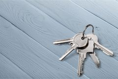 Five house keys on wooden background. House keys close up white background object nobody Stock Photography