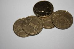 Five hryvnia with coins of Ukraine on a white background royalty free stock photos