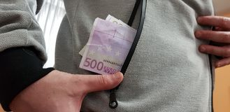 Five hundred euro bills in a pocket of white man stock photos