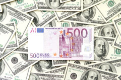 Five hundred euro and many one hundred dollars notes Royalty Free Stock Images