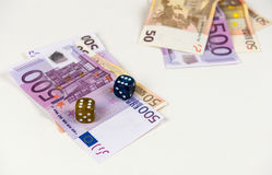 Five  hundred  and fifty Euro banknotes and dices Royalty Free Stock Photos