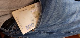 Five hundred hryvnia bill stacked in a jeans pocket stock image