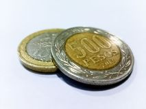 Five hundred peso coin. On a one hundred peso coin and with white background stock photo