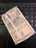 Five hundred rupees Indian currency notes on a laptop keyboard royalty free stock photos