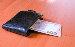 Five hundred Ukrainian hryvnia banknotes in black purse Royalty Free Stock Photos