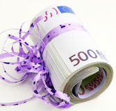 Five hundreds as a gift. With Gift Ribbons Royalty Free Stock Image