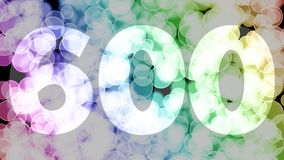 Five hundreds ninety nine to six hundreds points, level, rank fade in/out animation with color gradient moving bokeh background.