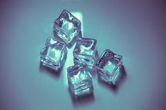 Five Ice Cubes Colored, on neutral background royalty free stock images