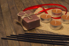 Five incense sticks and soap with candle Stock Photos