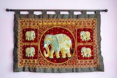 Five india elephants on silk gobelin. Brings luck, prosperity and happines Stock Photos