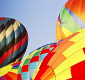 Five, Inflating Hot Air Balloons. Five, hot air balloons inflating for a morning ascension; copyspace center and left; New Jersey Festival of Ballooning Stock Photography
