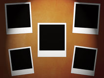 Five instant photos. On the vintage red dark background Royalty Free Stock Photos