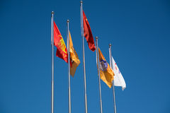 Five international flags blowing in the wind Royalty Free Stock Image