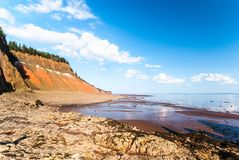Low Tide in the Bay of Fundy reveals ocean floor. Five Islands Provincial Park: View of the Bay of Fundy at low tide Stock Photo