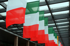 Five italian flags wave up Stock Photo