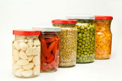 Five jars of preserved food Royalty Free Stock Image