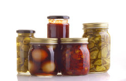 Five jars of preserved food Royalty Free Stock Photos