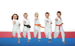 Five karate athletes beat a punch arm royalty free stock image