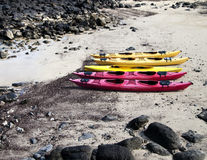 Five Kayaks On The Beach Royalty Free Stock Images