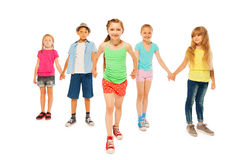 Five kids with happy little girl pull her friends Royalty Free Stock Photos