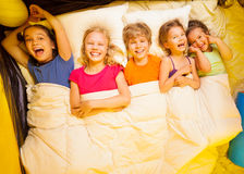 Five kids lay under blanket Royalty Free Stock Images