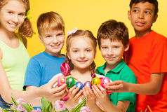Five kids portrait who hold Eastern eggs Stock Photos