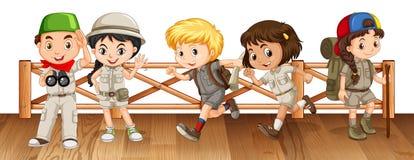 Five kids in safari outfit on the bridge Stock Photos