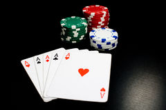 Five of a kind!. Photo of five aces and gambling chips Royalty Free Stock Photos