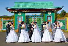 Five kissing marrying couples stock image