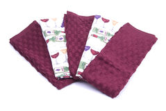 Five kitchen towels. Five kitchen hand towels maroon and printed Stock Photos
