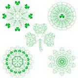 Five lace shamrock patterns Royalty Free Stock Photography