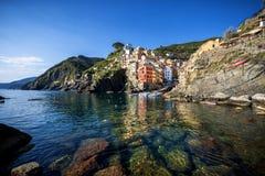 Five Lands Cinque Terre, Liguria: Riomaggiore fisherman village at sunset. Italy. royalty free stock photo