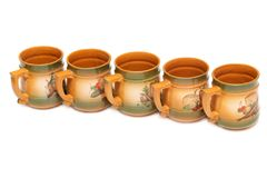 Five large ceramic mugs in red lined Stock Images