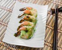 Five large shrimp prepared with an Asian style garlic sauce. stock photos