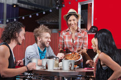 Plate of Pizza with Friends Stock Images