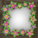 Five leaf blossom square frame on wooden surface Royalty Free Stock Image