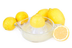 Five Lemons With A Juicer Stock Photo